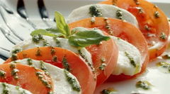 Cooking salad of mozzarella, tomato, greens - stock footage