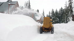 Snow Removal Equipment Clearing Road for Mountain Cabins - stock footage
