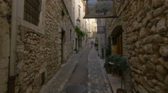 Walking by Galerie Frédéric Gollong and Caste store in Saint-Paul-de-Vence Stock Footage