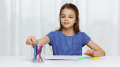 Happy girl drawing with  felt-tip pens at home Stock Footage