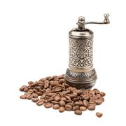 manual coffee grinder and coffee beans - stock photo