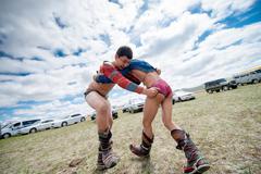 Darkhan, Mongolia - May 21, 2014:  Mongolia wresting during Naadam festival. - stock photo