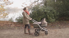 Mummy Pushing A Buggy Stroller With Her New Born Baby Stock Footage