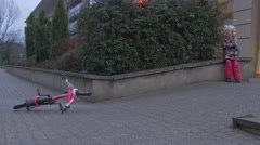 Kid Little Girl With Her Arms Crossed Bicycle Left on a Sidewalk Annoyed Child Stock Footage