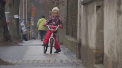 Little Girl Sits on a Pink Bike Riding a Bicycle Toward a Camera Little Girl is Stock Footage