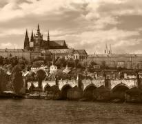 Charles bridge and St. Vitus Cathedral. - stock photo
