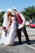 Zombie Bride And Groom Pose At Atlanta Pub Crawl Event Stock Photos