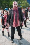 Group Of Bloody Zombies Stagger Along At Atlanta Pub Crawl Stock Photos