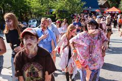 Horde Of Bloody Zombies Staggers Along At Atlanta Pub Crawl Stock Photos