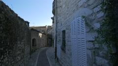 Stone buildings on a narrow street in Saint-Paul-de-Vence Stock Footage