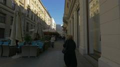 People walking by outdoor cafes on Preradoviceva street, Zagreb, Croatia Stock Footage