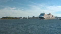 Queen Elizabeth Cruise Ship leaving Port Stock Footage