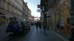 Cars and people passing by shops on Ilica street, Zagreb Stock Footage