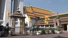 Flags outside a temple at Wat Po Stock Footage