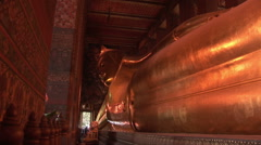 Giant golden Buddha at Wat Po Temple Stock Footage