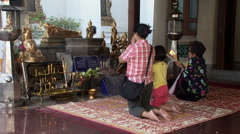 Thais pray at Wat Po Temple Stock Footage