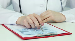 Medical scientist doing research, comparing graphs, statistics. Data analysis Stock Footage