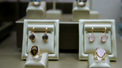 A close-up collection of rings and earrings Stock Footage