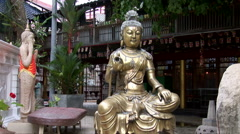 Gold statue inside the Gangaramaya Temple Stock Footage