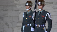 Tense looking soldiers at the changing of the guard ceremony in Taipei, Taiwan - stock footage