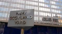 Rotating sign outside New Scotland Yard, Headquarters of the Metropolitan Police Stock Footage