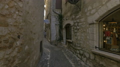 Tourists walking next to a Cafe and Cybele Atelier in Saint-Paul-de-Vence Stock Footage