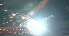 The welding machine assembling the square metal - stock footage