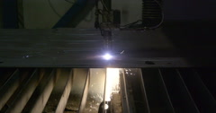 A plasma cutter making patterns from the metal sheet Stock Footage