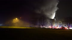 Wide Shot Heavy Smoke Pouring From a Large Structure During a 4 Alarm Fire - stock footage