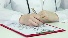 Medical student writing test during anatomy class, studying human physiology - stock footage