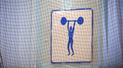 Sign weightlifting through volleyball net, the sound of the game - stock footage