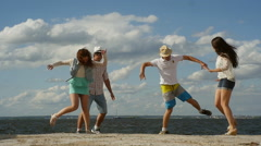 Group of Four Friends Having Fun on the Beach.  Funny Dancе - stock footage
