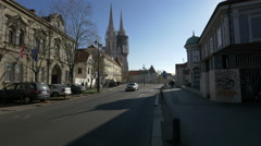 People walking and car driving on Kaptol street in Zagreb, Croatia Stock Footage