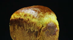 Homemade Bread Rotates on a Black Background Stock Footage