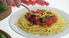 Italian dish of spaghetti pasta with tomatoes Stock Footage