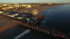 Flight over Santa Monica beach and pier - Los Angeles Stock Footage