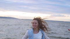 Young girl with braces and developing hair fun dancing on the beach - stock footage