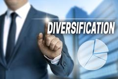 diversification touchscreen is operated by businessman - stock photo