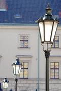 Three brass antique street lamps in a row, the city of history - stock photo