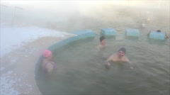 People bathe in hot springs in the winter - stock footage