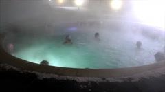 People bathe in thermal springs in winter recre - stock footage
