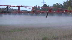 Sprayer equipment spray herbicides chemicals on field. Follow. 4K Stock Footage