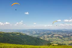 Skydiving  extreme over the mountains - stock photo