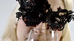 Vintage enigma woman in mask with glass of red wine - stock footage