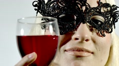 Anonymous woman in mask drinking red wine - stock footage