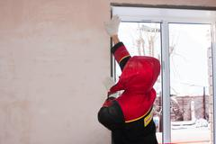 Stock Photo of PERM, RUSSIA, NOVEMBER 19.2015:Installation of  plastic window