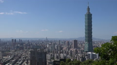 The iconic Taipei 101 skyscraper dominating the rest of the city's skyline - stock footage