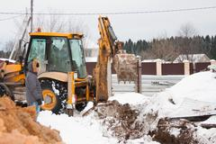 Stock Photo of PERM, RUSSIA, DECEMBER 15.2015: excavator working on a construction site