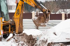 PERM, RUSSIA, DECEMBER 15.2015: excavator working on a construction site - stock photo