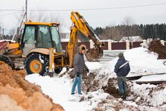 PERM, RUSSIA, DECEMBER 15.2015: excavator working on a construction site Stock Photos
